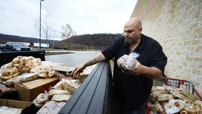 John Fetterman, seen here collecting food to distribute in Braddock, is a hands-on politician. He could liven up a usually dull lieutenant governor's race next year.