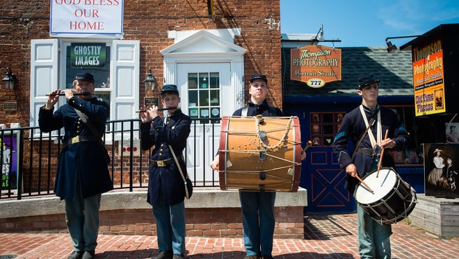 Members of the Calvert Arms Fife and Drum Corps from left, Dave Valentine, Chase Petro, Rickard Czar, and Thompson Dasher, perform at the end of the 150th anniversary commemoration of the National Homestead at Gettysburg on Saturday May 28, 2016 at 777 Baltimore Street in Gettysburg. The National Homestead, an orphanage, was opened in 1866.