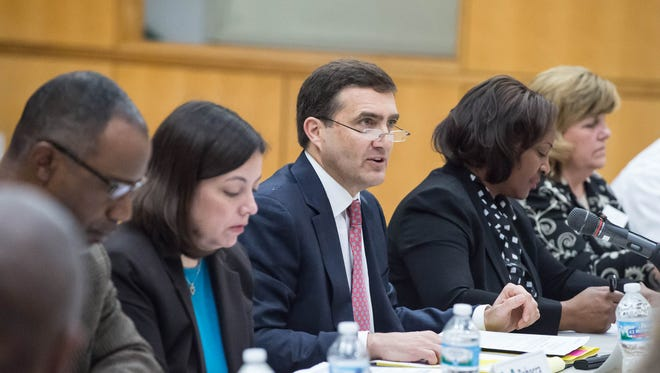 Kellogg Co. Chairman and CEO John Bryant, middle, speaks during the BC Vision Steering Committee meeting in March.