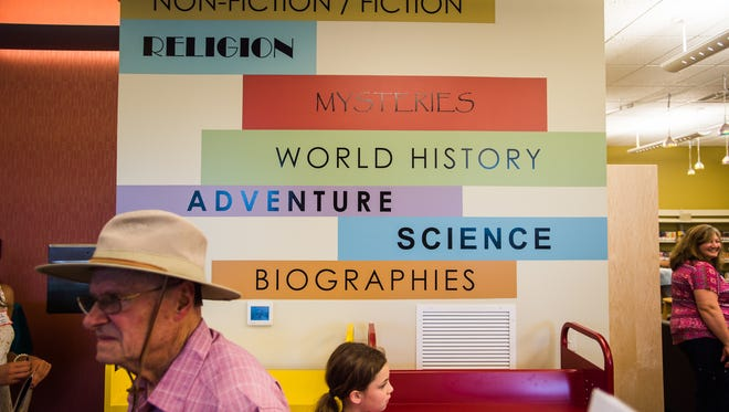 Visitors take a self-guided tour Sunday July 24, 2016 of the newly re-opened East Berlin Community Library.