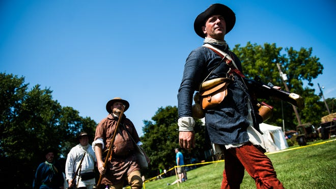 British re-enactors march in formation Saturday Aug. 20, 2016 during Mason and Dixon Day at the Mary Penn Bed and Breakfast near Gettysburg.