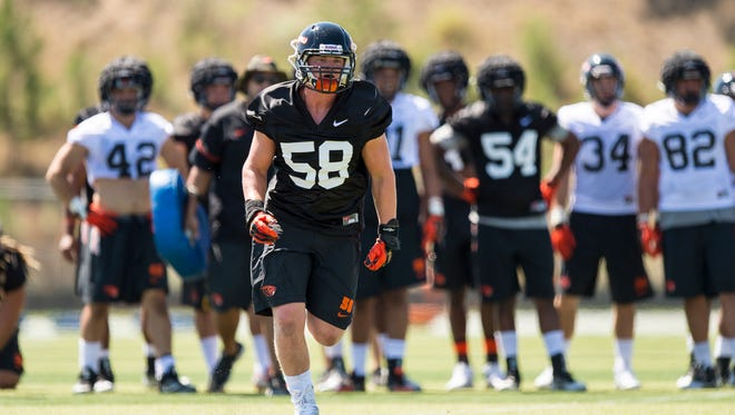 OSU linebacker Hamilton Hunt (No. 58), a redshirt freshman from West Salem High, will be on the traveling team for the season opener at Minnesota.