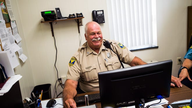 East Berlin police chief J. Michael Grim laughs while recalling his time as the East Berlin Police Department chief on Aug. 24, 2016. Grim is retiring from the position and being replaced by Officer Terry Seitz.