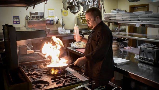 Jason Kurtz prepares a pasta dish at the Ace Bar & Grill on Wednesday, Aug. 31, 2016, in St. Cloud. Kurtz has recently created upscale menus for several beer-pairing dinner events.