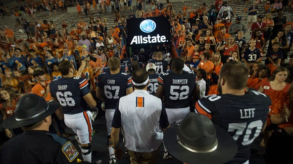 Auburn head coach Gus Malzahn walks out with Auburn offensive lineman Robert Leff (70), Auburn offensive lineman Xavier Dampeer (52), Auburn offensive lineman Tyler Carr (67), and Auburn offensive lineman Bailey Sharp (66) after the the Auburn vs. Texas A&M NCAA football game on Saturday, Sept. 17, 2016, at Jordan Hare Stadium in Auburn, Ala. Texas A&M defeated Auburn 29-16.