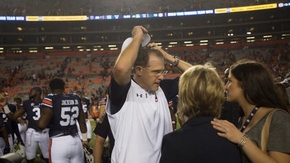Auburn head coach Gus Malzahn is greeted by his wife and daughter after the the Auburn vs. Texas A&M NCAA football game on Saturday, Sept. 17, 2016, at Jordan Hare Stadium in Auburn, Ala. Texas A&M defeated Auburn 29-16.