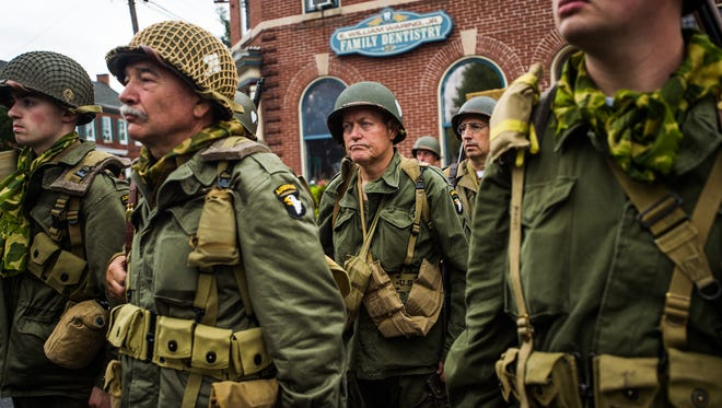 Allied re-enactors gather in New Oxford square after the Liberation of Nieuwe Oxford World War II re-enactment on Sept. 17, 2016 in New Oxford. This year's re-enactment coincided with the anniversary of Operation Market Garden, an airborne Allied assault that was unsuccessful.