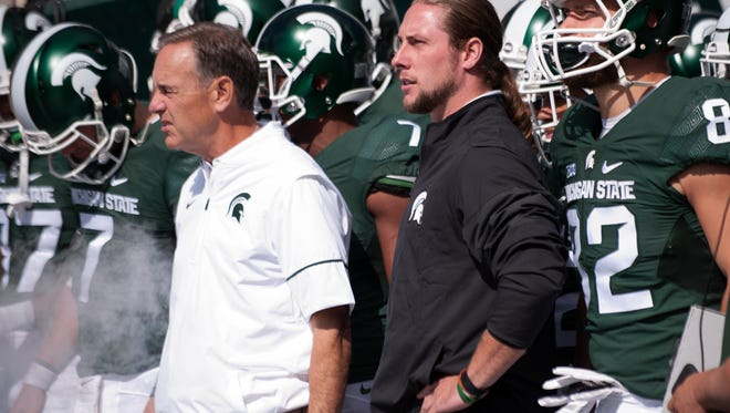 Senior linebacker Riley Bullough stands next to head coach Mark Dantonio as they wait to take the field before the game against Wisconsin on Saturday, Sept. 24, 2016 at Spartan Stadium in East Lansing. Wisconsin defeated Michigan State, 30-6.