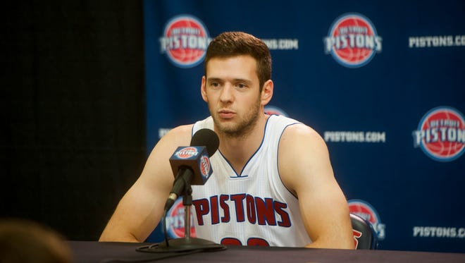 The Pistons' Jon Leuer answers questions during media day at the Pistons' practice facility in Auburn Hills on Monday.