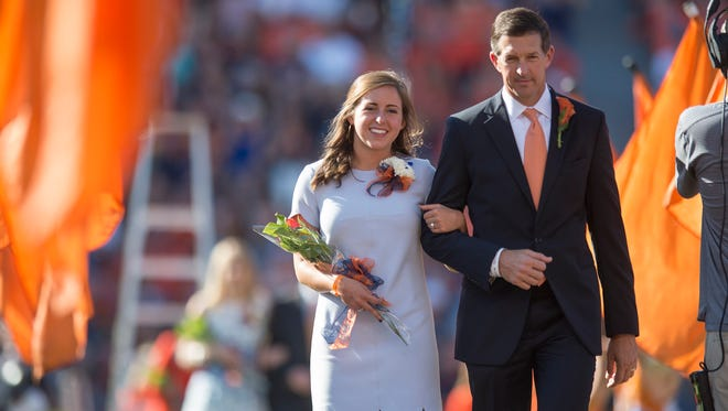 Kate Hardman is escorted by her father, Rob Hardman, before being announced as the Auburn Home Coming Queen during the Auburn vs. ULM NCAA football game on Saturday, Oct. 1, 2016, in Auburn, Ala.