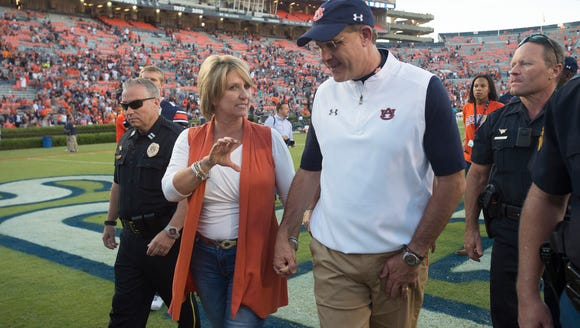 Auburn Tigers head coach Gus Malzahn walks with his