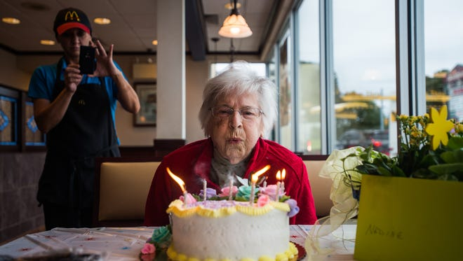 Nadine Baum blows out the candles on her birthday cake Thursday Oct. 13, 2016 at the south Hanover McDonald's during a 100th birthday celebration for the Hanover woman. Baum usually celebrates her birthday at the restaurant with her son Mike Baum.