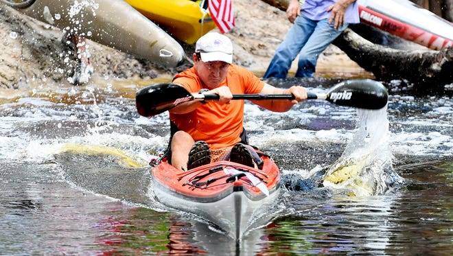 Doug Lindsay launches like a speed boat for a 1st Pace win in the men's Single Kayak during the 9th Annual RiverFest event held at Riverside Park in Bonita Springs in 2015.