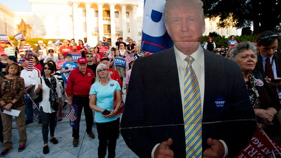 A cut out of Donald Trump stands during a Donald Trump rally outside the Alabama Capitol building on Tuesday, Oct. 25, 2016, in Montgomery, Ala.