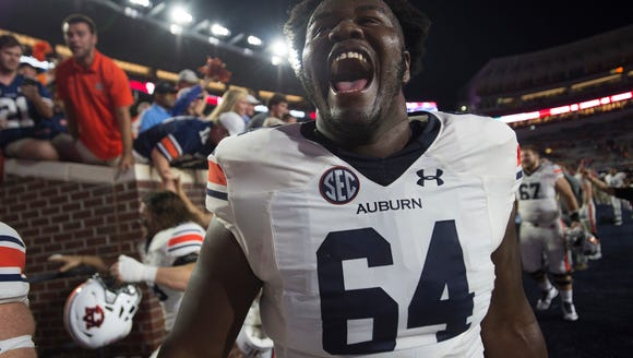 Auburn offensive lineman Mike Horton (64) celebrates