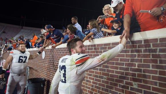 Auburn quarterback Sean White (13) celebrates with