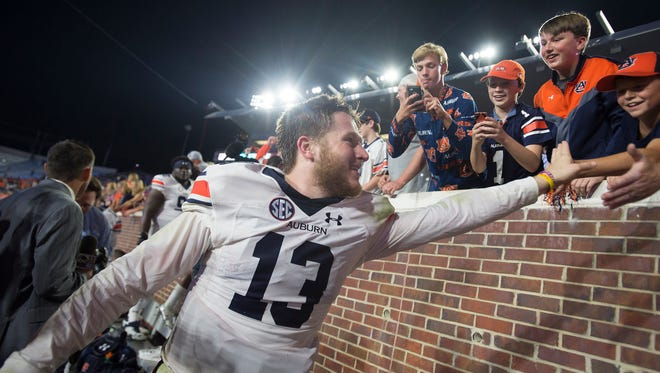 Auburn quarterback Sean White (13) celebrates with fans after the NCAA football game between Auburn and Mississippi at Vaught-Hemingway Stadium on Saturday, Oct. 29, 2016, in Oxford, Miss. Auburn defeated Mississippi 40-29.