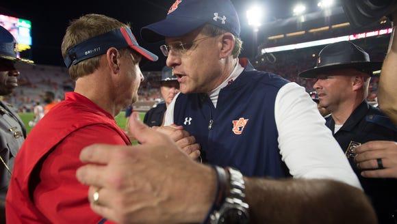 Auburn head coach Gus Malzahn  greets Mississippi head