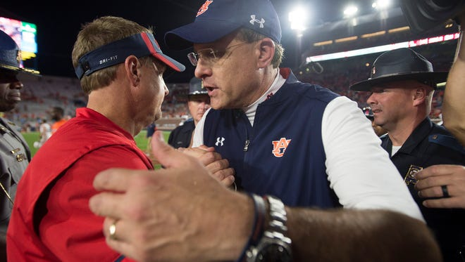 Auburn head coach Gus Malzahn  greets Mississippi head coach Hugh Freeze after the NCAA football game between Auburn and Mississippi at Vaught-Hemingway Stadium on Saturday, Oct. 29, 2016, in Oxford, Miss. Auburn defeated Mississippi 40-29.