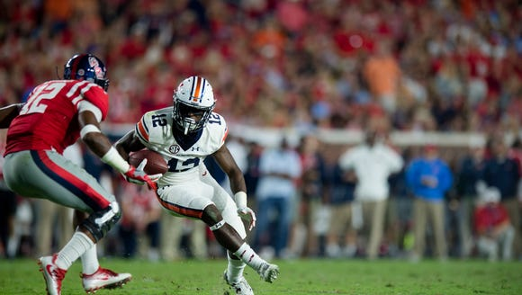Auburn wide receiver Eli Stove (12) is tackled by Mississippi