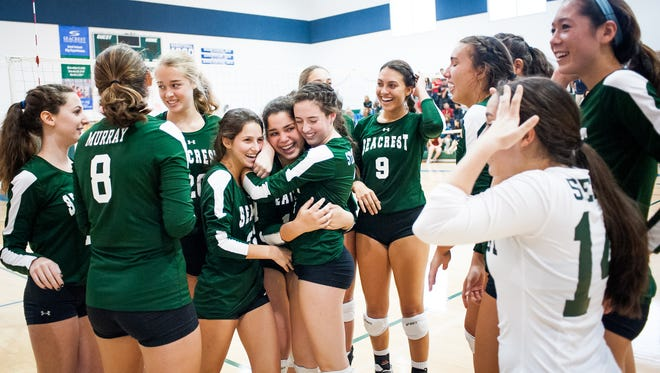 Seacrest girls volleyball team celebrates after a win against Evangelical Christian School in a Class 3A regional final match in Naples, Fla., on Saturday, Oct. 29, 2016.