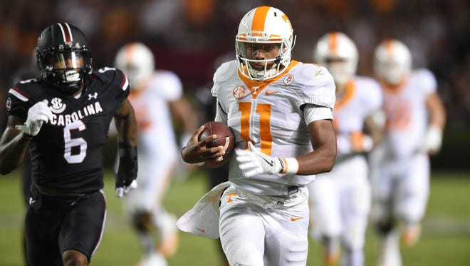Tennessee quarterback Joshua Dobbs (11) carries the ball to the end zone, but was called back on a penalty, during the first half at Williams-Brice Stadium on Saturday, Oct. 29, 2016.