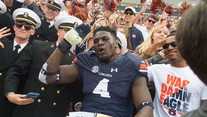 Auburn linebacker Jeff Holland (4) salutes while celebrating with fans after the NCAA football game between Auburn and Vanderbilt Saturday, Nov. 5, 2016, at Jordan-Hare Stadium in Auburn, Ala. Auburn defeated Vanderbilt 23-16.Albert Cesare / Advertiser