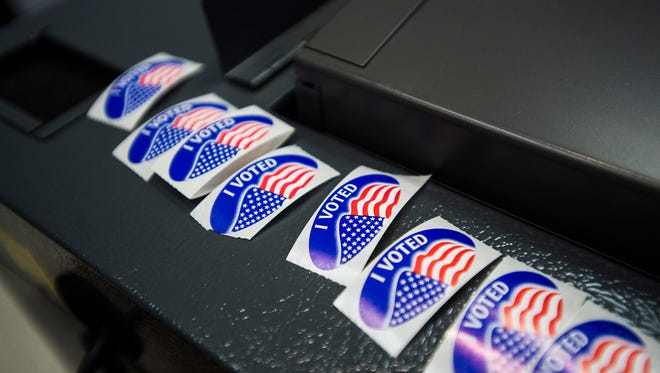 """Stickers wait next to the ballot machine at the Gettysburg first ward polling station on Tuesday night Nov. 8, 2016 in Gettysburg borough. Judge of Elections Jane Blocher said this election was """"higher than what it was four years ago,"""" in regards to voter turnout."""