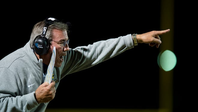 St. James head coach Jimmy Perry yells at his players during the AHSAA playoff football game on Friday, Nov. 11, 2016, in Montgomery, Ala.