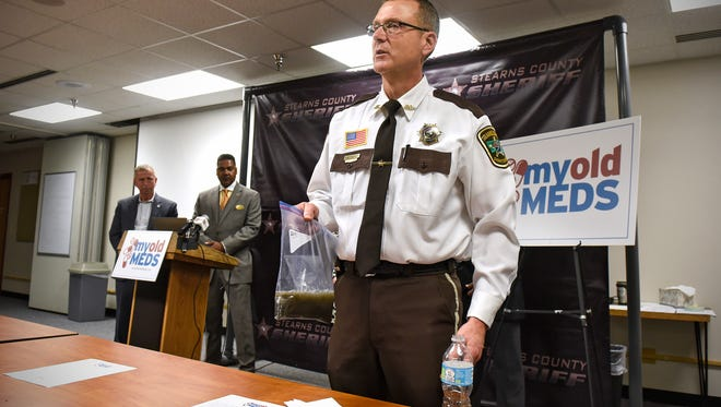 Stearns County Chief Deputy Bruce Bechtold demonstrates one method for safely preparing prescription drugs for disposal during a press conference Thursday, Nov. 17, at the Stearns County Law Enforcement Center.