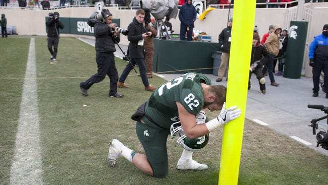 MSU senior tight end Josiah Price takes a moment after last week's game against Ohio State, his final game at Spartan Stadium. Price and the senior class are hoping to leave the program on a winning note at the end of a trying season.
