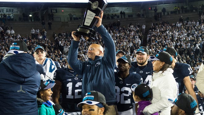 Penn State's head coach, James Franklin holds up the Land Grant Trophy after defeating Michigan State 45-12 on Saturday, Nov. 26, 2016, at Beaver Stadium. Penn State won the Big 10 East championship.