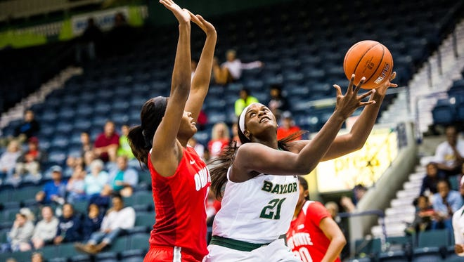 Baylor University's Kalani Brown tries to go for a layup as Ohio State's Tori Mccot attempts to block during the basketball championship against Ohio State University in the Gulf Coast Showcase at Germain Areana in Estero, Fla., on Sunday, Nov. 27, 2016.