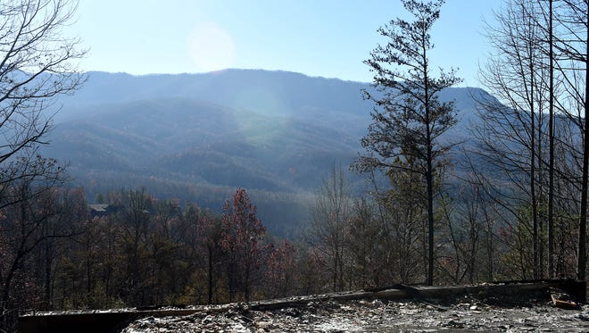 Property damaged in the Cobbly Knob area after wildfires ran through the Pigeon Forge and Gatlinburg, Tenn. earlier in the week, Thursday, Dec. 1, 2016.