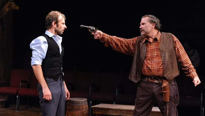 """David Bendena and Jim Porterfield are pictured in a 2016 staging of """"The Man Who Shot Liberty Valance"""" at Tipping Point Theatre in Northville, Michigan."""
