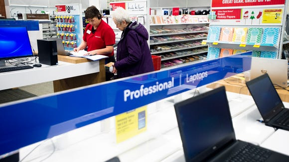 Lisa Pace, Office Depot manager, helps a customer at the Office Depot in the Vaughn Plaza Shopping Center in Montgomery, Ala., Monday, Dec. 19, 2016.
