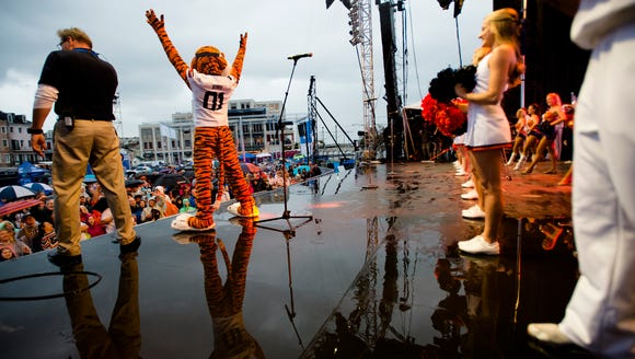 Aubie dances during the Auburn Pep Rally at the All