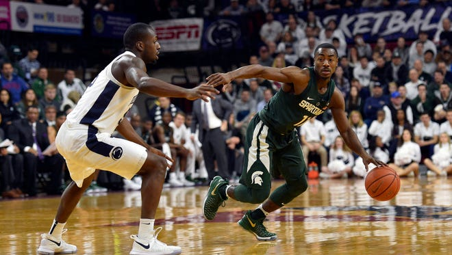 Jan 7, 2017; University Park, PA, USA; Michigan State Spartans guard Lourawls Nairn Jr. (11) dribbles past Penn State Nittany Lions guard Terrence Samuel (5) during the first half at Palestra. Mandatory