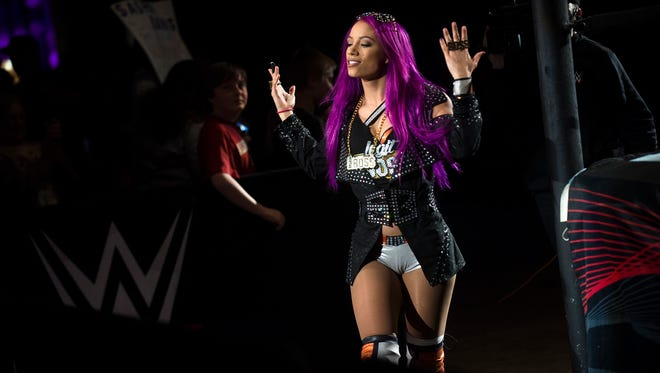 Sasha Banks takes the ring during the WWE Raw Live performance at the Garrett Coliseum in Montgomery, Ala., on Saturday, Jan. 7, 2017.