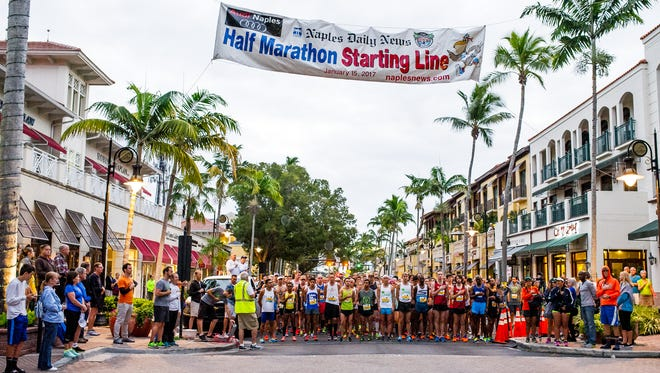 Runners listen to the National Anthem as they line up at the starting line of the Naples Daily News Half Marathon in Naples, Fla. on Sunday, Jan. 15, 2017.