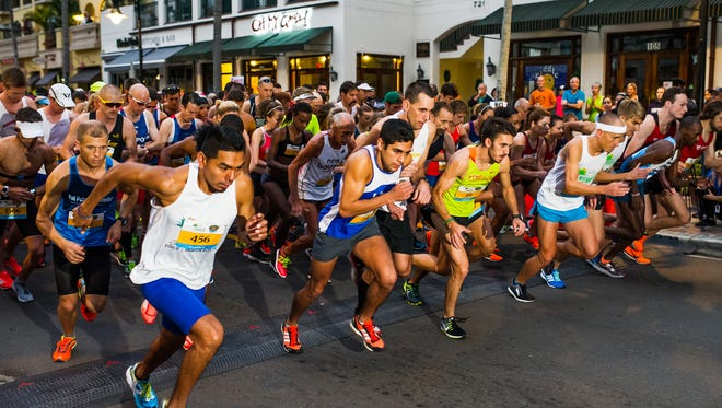 Runners take off at the starting line of the 2017 Naples Daily News Half Marathon on Sunday.