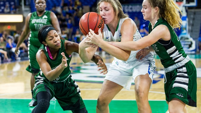 Florida Gulf Coast University's Samantha Kisiel fights USC Upstate's Breanna Jefferson(3) and Rylie Parkhurst(10) for the ball during a game against USC Upstate at Alico Arena in Fort Myers, Fla., on Monday, Jan 23, 2017.