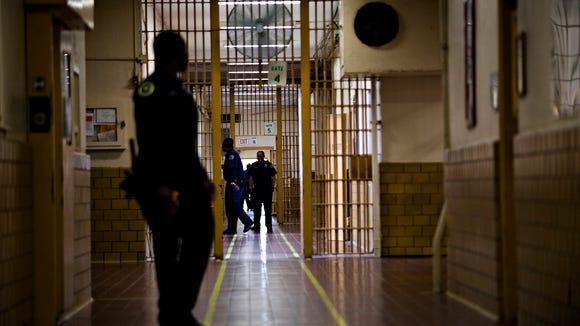 Prison Guards walk down the corridor at Draper Correction