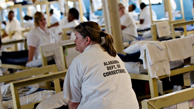 Inmates sit on their bunks Tutwiler Women's Correction Facility in Wetumpka, Ala., on Monday, Feb. 6, 2017. Tutwiler is Alabama's second oldest corrections facility.