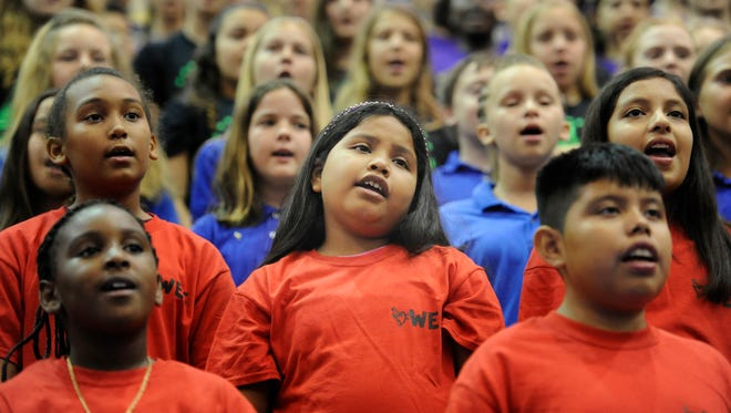 "Warfield Elementary School students sing ""Listen To The Rain"" during the 42nd annual Music in our Schools concert March 29, 2016 at Martin County High School in Stuart."