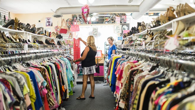 People do some shopping at Twice as Nice Consignments in Naples, Fla., on Tuesday, Feb. 21, 2017. Twice as Nice Consignments on Second Avenue North in downtown Naples has recently taken over the space next door, knocked down the wall in between and nearly doubled its initial 1,700-square-foot store front.