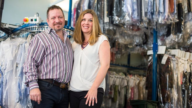 Andrew and Lynette Rhodes stand in their shop in Naples, Fla., on Tuesday, Feb. 28, 2017. In October 2014 the couple purchased Platinum Dry Cleaners in Naples from Joe and Sandy Waite, who started Platinum in 1989. Since March 2016, they have purchased four more dry cleaners from Marco Island to Estero.