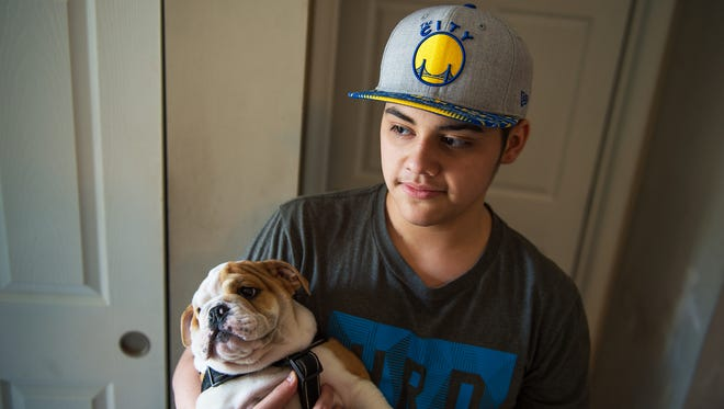 Jaaziel Daniel Alicea, 14, holds his puppy, Jay, an English bulldog, inside of his home on Friday, March 10, 2017 in Waynesboro, Pa. The Make A Wish foundation granted Alicea, who has Hodgkin's Lymphoma, his wish, giving him the dog.