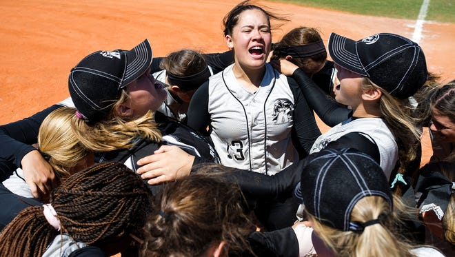 Robinson High School celebrates after winning the Bill Longshore Memorial Softball Tournament at North Collier Regional Park in Naples on Saturday, April 8, 2017.