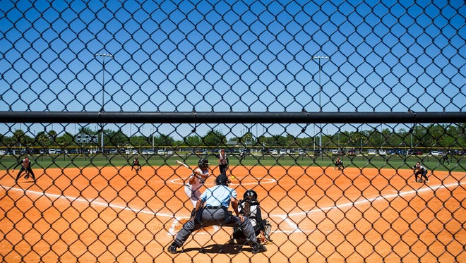 Robinson High School and Treasure Coast High School face off in an early inning of the championship game of the Bill Longshore Memorial Softball Tournament at North Collier Regional Park in Naples on Saturday, April 8, 2017.
